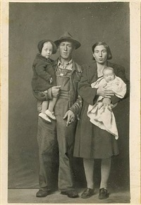 untitled [man holding toddler girl, woman holding infant] by mike disfarmer